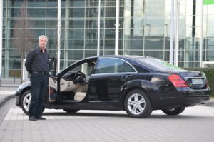 driver with luxury sedan ct