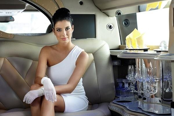 Beautiful smart woman sitting in limousine.